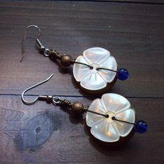 Wire Wrapped Button Earrings Made With Vintage Buttons. $10.00, via Etsy.