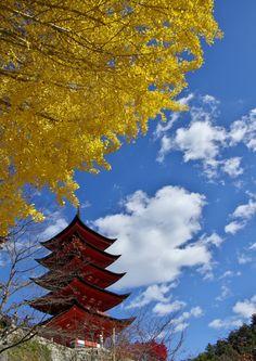 Five-storied Pagoda and Autumn Leaves in Miyajima, Japan.