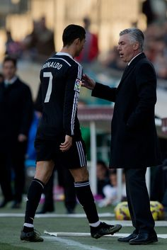 Head coach Carlo Ancelotti (R) of Real Madrid CF speaks to Cristiano Ronaldo (L) as he leaves the pitch after being reprimanded with a red card during the La Liga match between Cordoba CF and Real Madrid CF at El Arcangel stadium on January 24, 2015 in Cordoba, Spain.