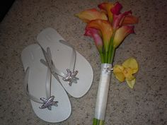 bridesmaid stuff: starfish flip flops, calla lily bouquet with a crystal starfish on the stem, and yellow orchid hair clip