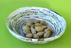 Magazines can be recycled into coiled paper baskets that are reminiscent of wood's concentric rings or turned wood. Using a magazine and 1 pint of rice glue, you can make a fruit bowl, a pencil holder or a basket for trinkets.