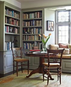 A graceful game table claims a sunlit corner of a library in a rambling Spanish-style Hollywood home. - Traditional Home ®/ Photo: Werner Straube / Design: Madeline Stuart #TraditionalDecor