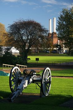 Battery and Battersea. One of the canons from the Waterloo Battery at the Royal Hospital  Chelsea. Battersea Power Station and Chelsea Bridge can be seen in the  background.