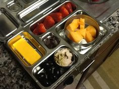 Cheese, strawberries, cantaloupe, olives, leftover pork, and choc chips