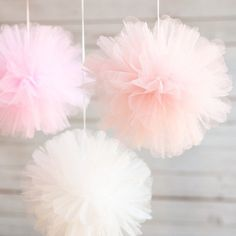 These pretty pink tulle pom poms are such a cute accessory for your little one& birthday party! Perfect for celebrating a little girl, each of the three pom poms comes in a different shade and beautifully adds texture to the decor. Birthday Party Decorations, Baby Shower Decorations, Birthday Parties, Tulle Decorations, Girly Baby Shower Themes, Girl Christening Decorations, Pinwheel Decorations, Party Favors, Hochzeit