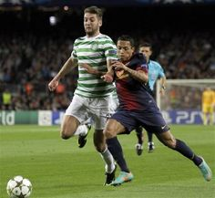 Celtic's Charlie Mulgrew, left, challenges FC Barcelona's Adriano for the ball with during a Champions League Group G soccer match at the Camp Nou, in Barcelona, Spain, Tuesday, Oct. 23, 2012. (AP Photo/Felice Calabro')
