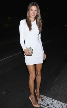Alessandra Ambrosio in a long-sleeved white mini-dress and a pair of sky-high nude stilettos.