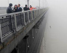 A young man jumps from the Yangtze River Bridge in Wuhan, China, into the river following another person who committed suicide minutes earlier.