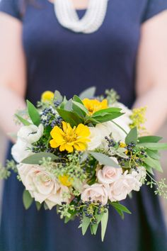 bouquet with pops of yellow, photo by Brooke Photography and Design http://ruffledblog.com/nautical-inspired-anniversary-shoot #weddingbouquet #flowers #bouquets