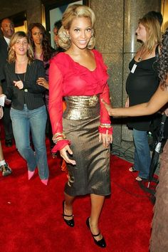 Beyonce in 2004 at Fashion Rocks event in N.Y in red blouse and metallic pencil skirt.