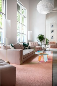 blush sofa, iridescent coffee table + statement lighting