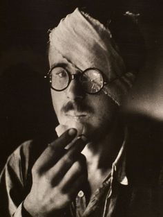 Broken Glasses, Breslau, 1943, aphoto byZdeněk Tmejof one of his fellow prisoners at the German forced labor camp 1941-43
