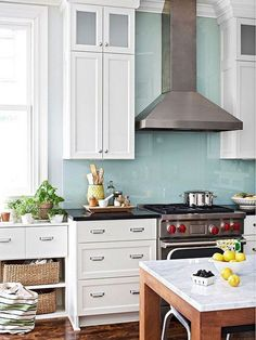 Love the backsplash! (nothing else) Source: Not Your Basic Backsplash: A Lovely, Low-Maintenance Alternative to Tile. I like this glass backsplash Glass Backsplash Kitchen, Glass Kitchen, Kitchen Countertops, New Kitchen, Kitchen Dining, Backsplash Ideas, Kitchen Pegboard, Kitchen Ideas, Backsplash Design