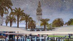 San Francisco riflessa in pozzanghere e mondi capovolti