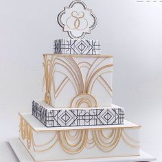 Great Gatsby theme wedding cake in black, white & gold. @rbicakes.