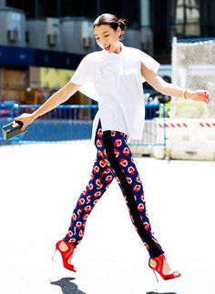 1 Trick Guaranteed to Make Your Pants More Flattering via @WhoWhatWear--- floral tuxedo pants with red sandals