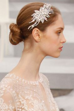 A simple bun becomes oh-so-eye-catching with a bold embellishment.