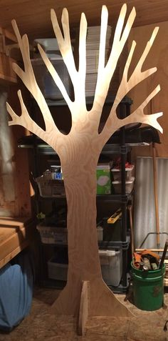 8' x 4' tree to be stained in dark walnut.  Will add foliage: Plastic tablecloth vines in leaf shape for the scary fores.) Green sparkly tule attached to fishnet for the Lion forrest.  back is the same as the front.