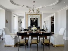 Traditional Dining Room. I LOVE the painted chairs and Leopard Fabric!