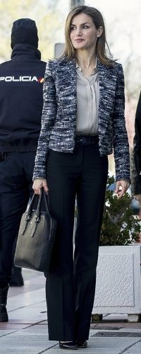 Today, Letizia paired the jacket with her Hugo Boss 'Bedina' silk-blend blouse (£220) and Hugo Boss 'Tuliana' navy trousers (£159) which she finished with a croc leather belt.  Letizia added a hint of sparkle to her outfit, wearing the Chanel Comète earrings.