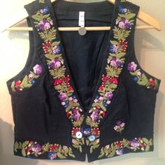 FREE PEOPLE RARE. Embroidered vest. RARE. Never worn, mint condition. This is probably one of FP finest pieces. The most spectacular embroidered details. Throughout front and back. Cute little pocket detail. A must see to appreciate. If you love FP check out my closet!! Price is negotiable, but very little wiggle room. Free People Jackets & Coats Vests