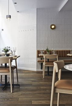 restaurant wall could we tile the entry wall Tan cushion on white bench and brass wall light. Michel Restaurant Helsinki by Joanna Laajisto Interior Design Blogs, Restaurant Interior Design, Interior Design Inspiration, Interior Ideas, Restaurant Interiors, Brewery Interior, Cafe Interiors, Furniture Inspiration, Architecture Restaurant
