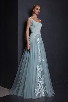 Watergreen A-line evening gown with a Tulle skirt, bodice made of Moroccan Crepe mixed with lace and embellished with Silk thread embroideries.