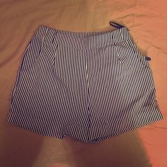 Striped formal/business shorts A cute pair of striped shorts for business or pleasure! The second picture is a cute way to wear business shorts. :) Miami Shorts