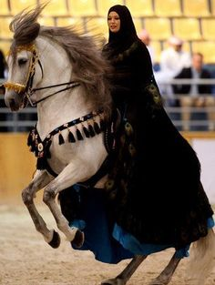 Muslim woman competing, from an International Horse back Competion.