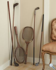 Love the idea of vintage rackets and clubs as decor