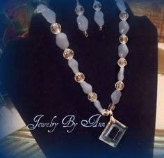Eye catching periwinkle earring & necklace set with a unique pendant that will sure bring you many compliments. Designed & created by Ann Ray. $15.00 + S&H. PayPal. Contact info: annray253@bellsouth.net & 229-460-0051
