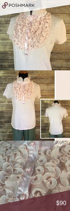 """ADRIENNE VITTADINI  Lots of Ruffles Top ADRIENNE VITTADINI Ruffles short sleeve button up Top in blush pink. This is a quality made top. Beautiful satin button placket with crystal-like buttons. Tons of ruffles on front & collar. Ruffles have piping at edges to keep their shape. New with tags. Bust measures 18 1/2"""" flat across front. Top is cut straight down. Perfect to tuck in or add a belt. Shoulder to shoulder 15"""" wide. Length 22"""". Sleeve length 5.5"""". Some stretch. Offers always welcome…"""