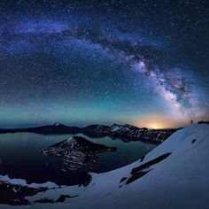 The Milky Way creates a rainbow of stars above Crater Lake National Park in Oregon. On a cold, clear night, photographer Majeed Badizadegan captured multiple vertical shots to create this panoramic image, where the foreground is lit entirely by starlight. Photo courtesy of Majeed Badizadegan.