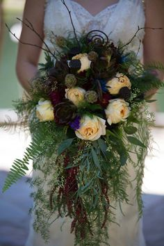Fall wedding bouquet with Dahlias + Succulents + Carnations + Spider Mums + Garden Roses + Greenery + Amaranthus + Lotus Pods + Monkey Tails.