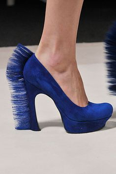 Bright blue pony-maned pumps from YSL