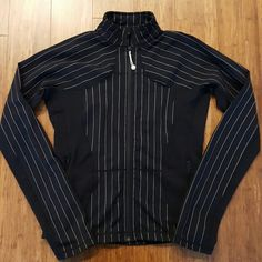 Lululemon striped jacket Good used condition black striped jacket. Some pilling around underarms and lightly in other parts but material is strong and functional. Still a nice jacket. No rip tag or size dot. I wear a 6 in tanks and guess this is an 8 but pls use measurements to ensure fit!!! Measures approx 18.5 inches armpit to armpit, 15.5 across waist at top of zippers, and 23 in length. No trades, PP, or lowball offers please.  Cheaper on M. lululemon athletica Jackets & Coats