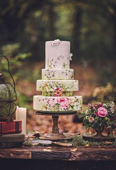Lunchtime Wedding Treat - Oh my days. This is the prettiest wedding cake I have ever seen. The hand-painted floral design is so beautiful and I love the three dimensional butterflies. The unusual size tiers make this cake such a visual delight. Cake by Nevie-Pie Cakes
