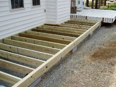 A great idea for a floating deck as it is placed on cinder blocks instead of being attached to the house - #DIYGardenIdeas
