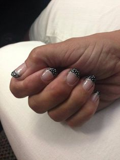 Black French tip nails with polka dot accents  - gelish