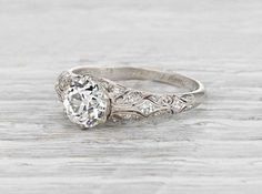 Antique Edwardian engagement ring made in platinum and set with a 1.05 carat GIA certified old European cut diamond with H color and VS2 clarity. Circa 1916. The ring represents the type of classic and beautifully designed vintage engagement rings we live for! This Edwardian stunner features intricate filigree accented with small diamonds and impeccable craftsmanship. Diamond and gold mining has caused devastation in areas such as Africa, wreaking havoc on delicate ecosystems and