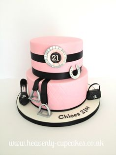 A two tier chocolate celebration cake filled with chocolate lots of buttercream. The customers brief was a pink and black 21st Birthday cake with a horse riding, shoe and handbag theme. The lower tier was delicately embossed with a diamond print to add texture and then we added a number 21 rosette, horse shoe, stirrups and Gucci handbag and shoes. The cake was finished with a 21st Birthday message.