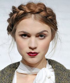 A crown of braids is just as in for Fall as it is for Summer. Hairstylist Antonio Corral Calero created the look with a middle part and two pigtail braids behind the ears. He then crossed the textured plaits over the top of the head and secured with pins for a hairstyle that only seems complicated.