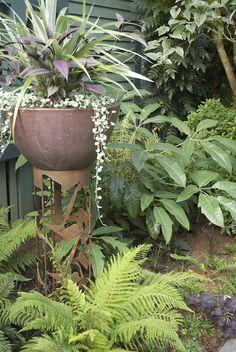Rusted metal bowl on pedestal