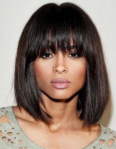Ciara's modern shag cut features super straight strands that curl slightly inward at the ends