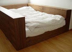 This would solve my problem of always wanting but not ever having my bed against a wall to get that cozy protected feel...