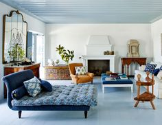 mixed patterns in shades of blue and a hit of orange in this formal living room | green island home tour via coco kelley
