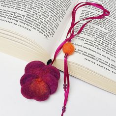 This charming needle felted pansy bookmark is a very nice gift for book lovers or for yourself. This needle felted bookmark is made from 100 % wool with a lot of love and patience. It also has also some glass bead elements. A needle felted pansy flower has been attached to one end of a satin ribbon and needle felted hearts and balls have been sewn to the other. Great for your collection or for present to somebody special.  This pansy bookmarks size is approx. 18.1 inches ( 46 cm ) long and…