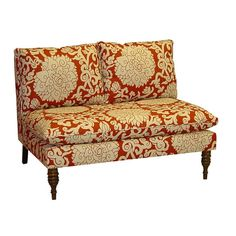 Pillow top settee with bittersweet-toned floral upholstery and spindle legs. Handmade in the USA.    Product: Settee...