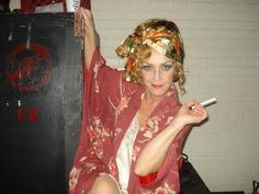 Miss hannigan. I like the hair and scarf; not the cigarette...