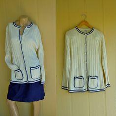ivory cardigan with navy blue trim . vintage 1960s . pockets . unisex medium - but it at www.nesteggvintage.etsy.com